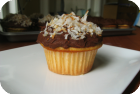 almond cupcakes with dark chocolate frosting and toasted coconut